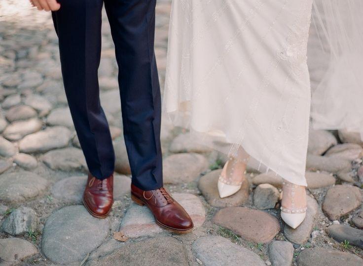 Groom's Suit: J.Crew - www.jcrew.com Bride's Shoes: Valentino - http://www.stylemepretty.com/portfolio/valentino-4 Wedding Dress: The Wedding Shoppe - http://www.stylemepretty.com/portfolio/the-wedding-shoppe-in-wayne   Read More on SMP: http://www.stylemepretty.com/2014/05/23/art-deco-ballroom-wedding-in-philly/