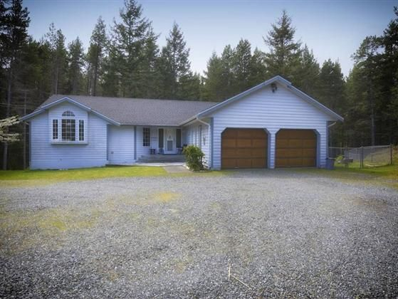 Privacy size and location This 2.5 acre property is tucked away in a highly sought after area of Comox Peninsula just minutes from the Point Holmes boat launch. This custom built - main level entry home offers enough space for everyone.