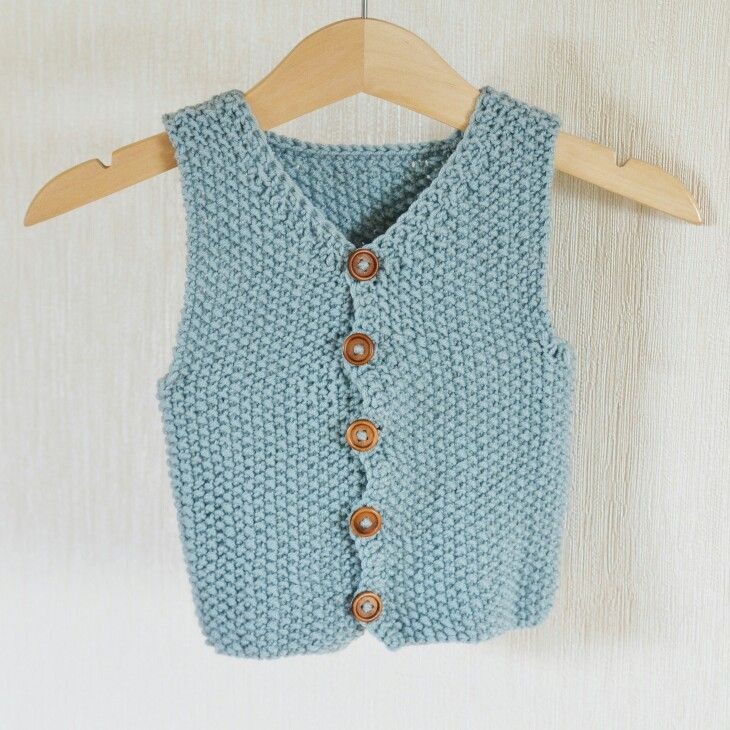 Knitted baby boys vest.