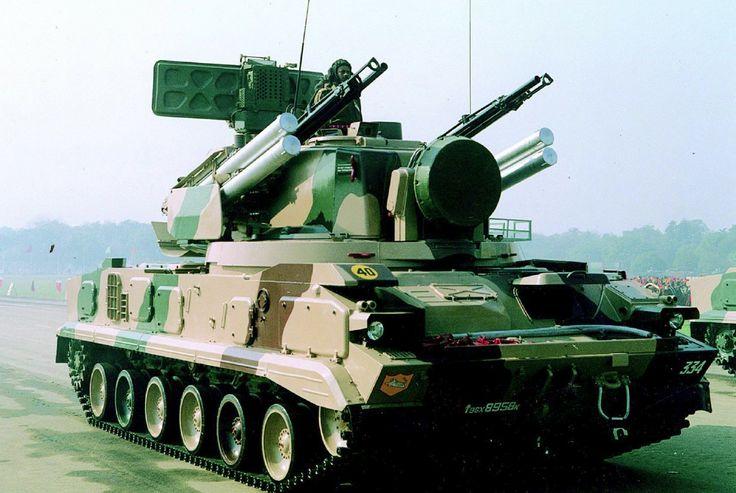 9K22 Tunguska Russian SPAA - 2x 30mm AC and 4xSAM.  http://en.wikipedia.org/wiki/9K22_Tunguska