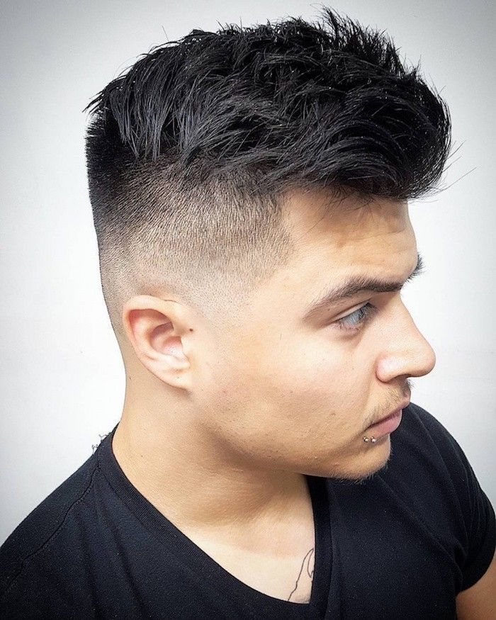 how to style a undercut, young man with dark hair, kept longer on top, shaven on the side, wearing black t shirt, with two piercings on his lip and a chest tattoo