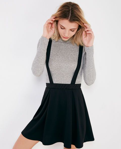 <p>This trendy pinafore skirt features a super soft knit fabric, a paneled design, a flirty flared silhouette, an elasticized waistband, and thick crisscross straps.</p>    <p>Model wears a size small.</p>    <ul>  	<li>17.5