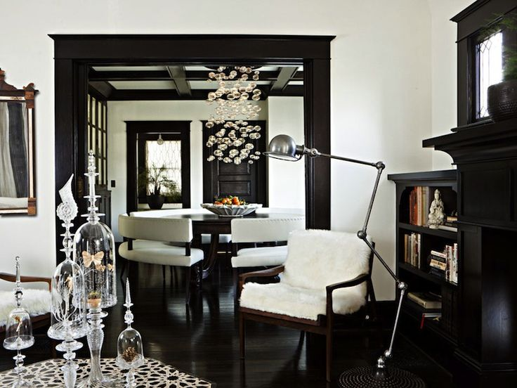 Love the white cream paint wall colors with dark floors and black molding fantastic mid century for Black and white living and dining room