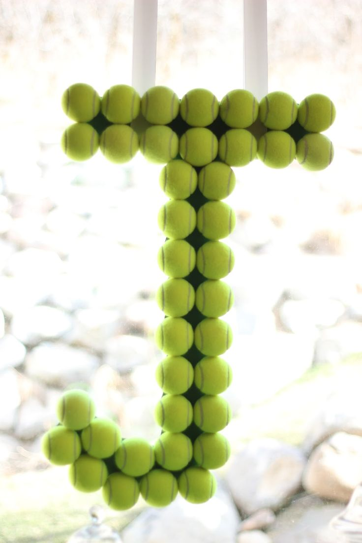 Jake's 13th Tennis Birthday Party... use tennis balls to make initial of the birthday child as a decoration