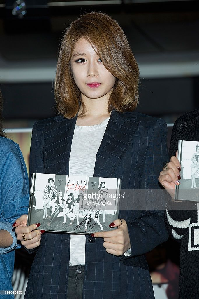 Jiyeon (Ji-Yeon) of South Korean girl group T-ara poses for media at their 8th Mini Album 'Again' record release signing at IFC Mall on October 27, 2013 in Seoul, South Korea.