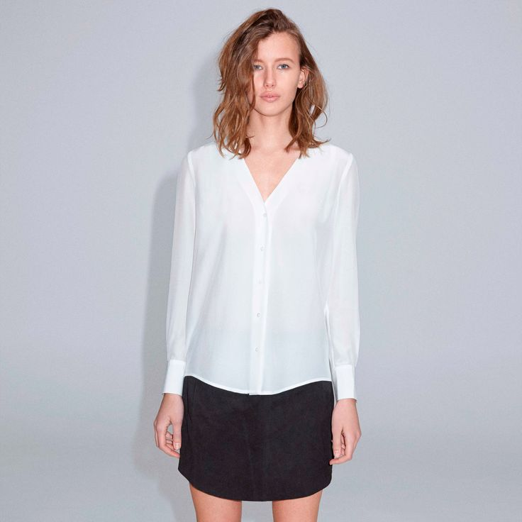 FWSS Island Song is a classic feminine silk shirt with a deep V-neck, pleats at the back and a visible button stand.