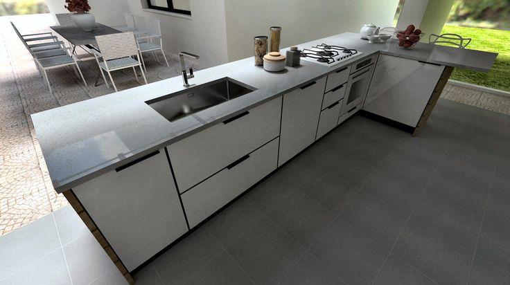 In esterno come e più che in un interno per questa cucina realizzata in compensato marino con frontali in vetro e alluminio.