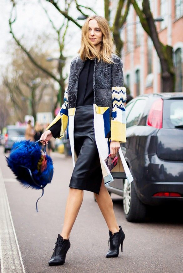 Statement street style: printed coat + leather skirt + blue furry purse + black lace-up black ankle boots