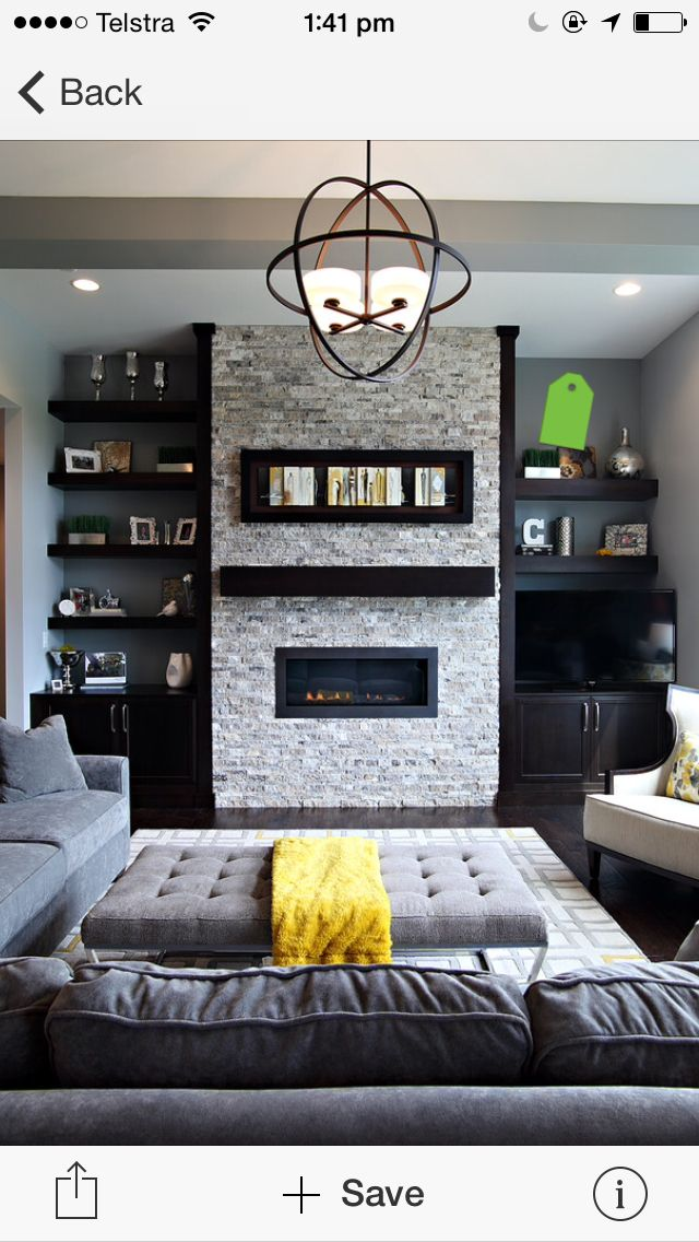 Black shelving & fireplace