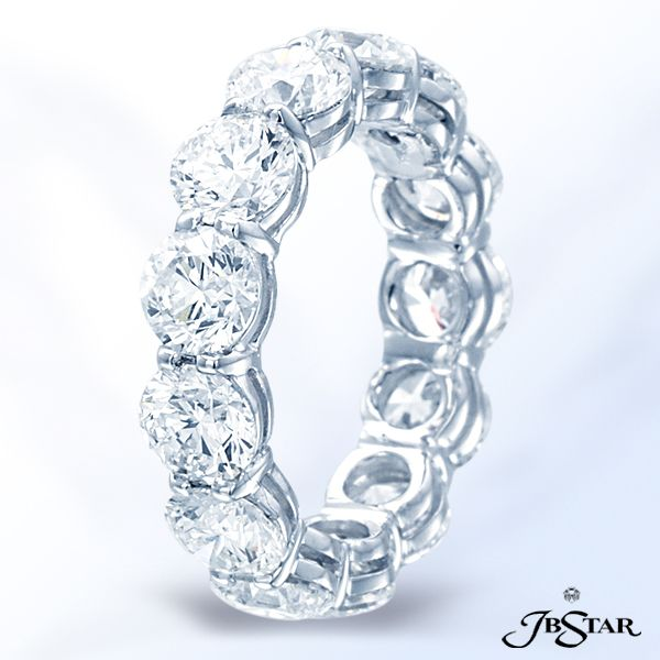 Style 0998 Stunning platinum and round diamond eternity band featuring 13 round diamonds in a shared prong setting. @jewelsbystar #platinum #eternity #band