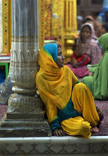 India - woman relaxing at a street market
