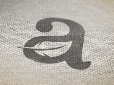 "Great use of negative space in this combination letter ""a"" and leaf mark."