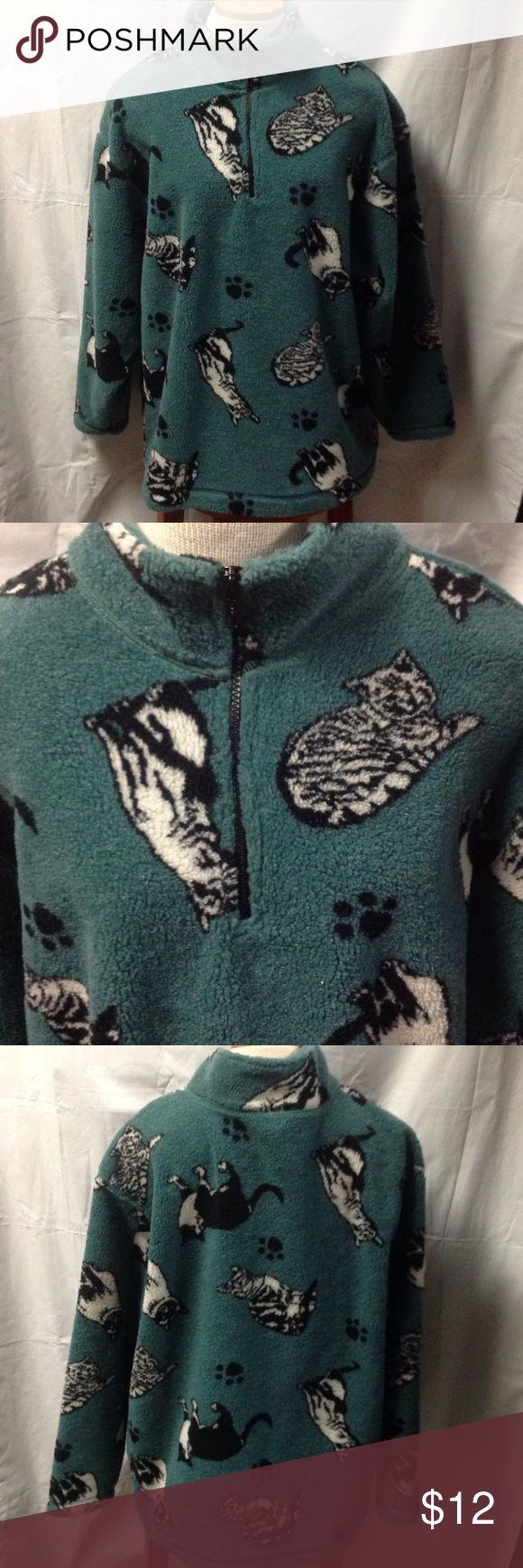 "JUST IN⭐️Cat Lovers half zip fleece. Size Large Cute gift for the ""Cat Lady"". Teal greenish background, half zip, black and white cats and cat prints. Measures approx. 28"" in length, sleeves measure approx. 21"", shoulders 7"" each. Bust measures approx. 40"". Good pre-loved condition. Winona Tops Sweatshirts & Hoodies"