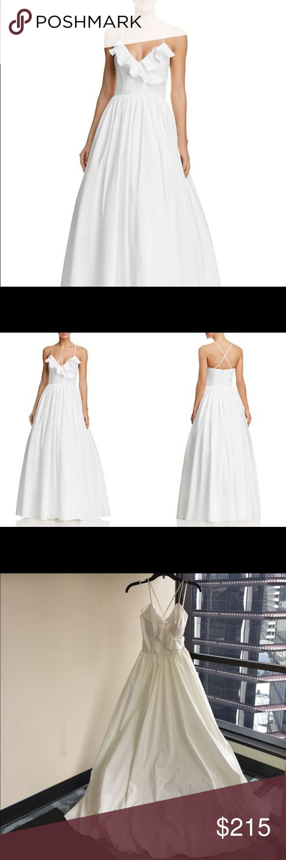 """Avery G white ruffle gown - excellent condition White ruffle ball gown perfect as a wedding dress. Worn once for photo shoot. Small stains on the bottom of the dress as shown on photos. Beautiful silhouette, lightweight and simple ruffle embellishment. The height on the model is 5'10"""", A cup size, waist 32"""". Size 0. There is a little padding by the bust area. Best worn with silicon adhesive pasties. Smoke free home. Cross-back strap, full skirt, tulle underlay. Dry clean. Avery G  Dresses…"""