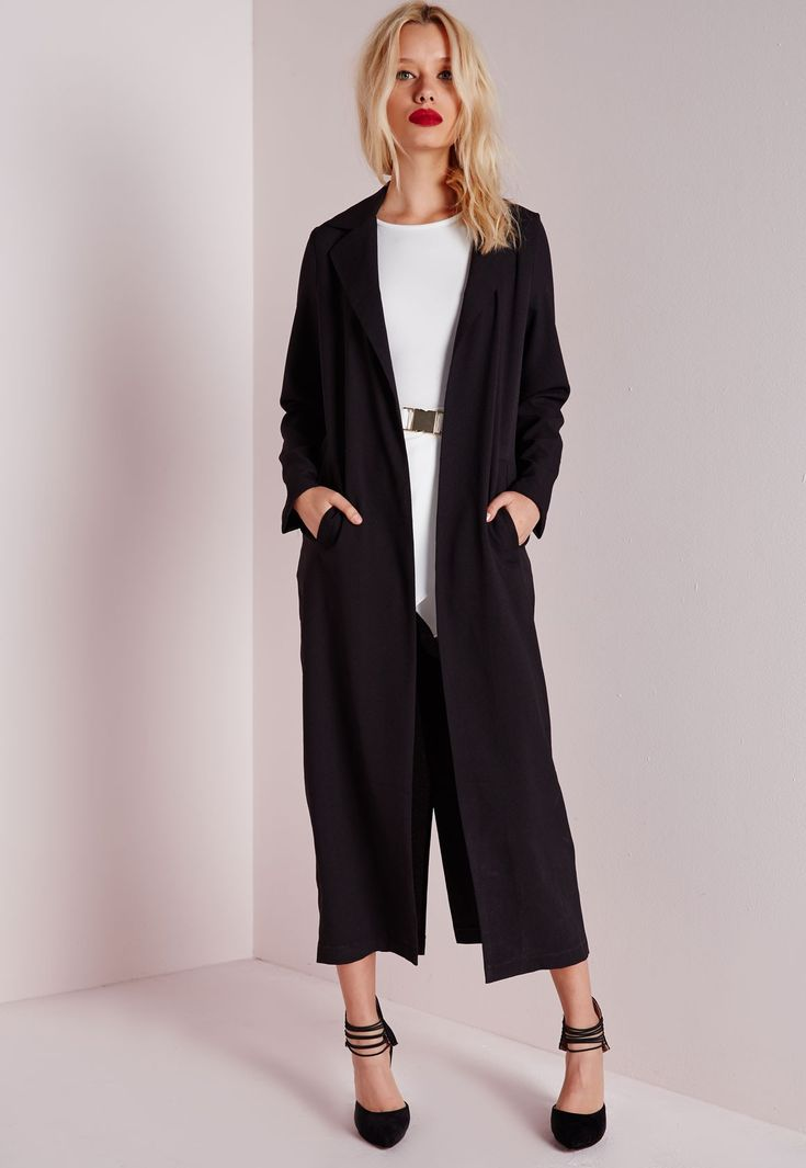 We're vibin all over this long line black maxi duster coat this season here at Missguided. With luxe long sleeves, pockets to the hips and seriously smokin' kick split to reverse this coat will ensure all eyes are on you! Style this on ...