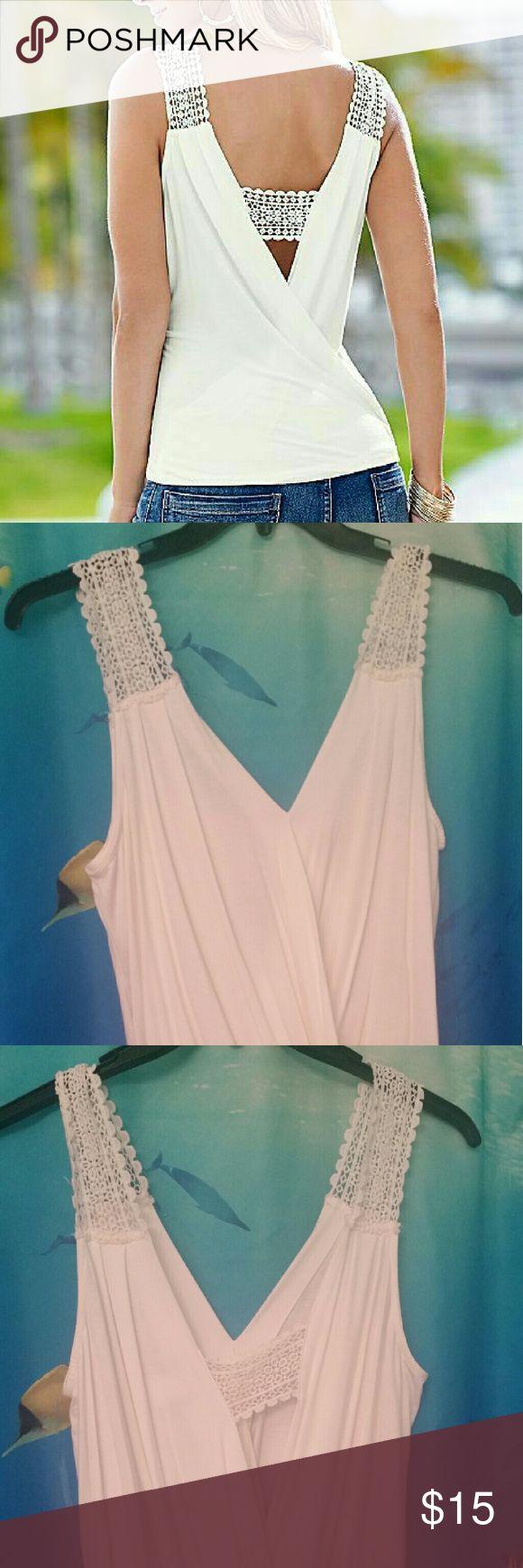 Venus sleeveless crochet detail surplice top New without tags sleeveless crochet surplice top.  Flattering v neck line..elastic at waist..off white Venus Tops Tank Tops