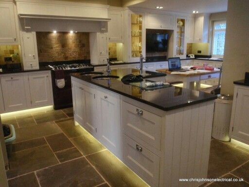 LED Kitchen lighting. 14.4w strip for under cupboard and plinths, 6w Megaman GU10 lamps in Aurora fittings