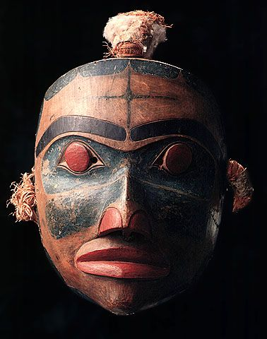 This dance mask dating from about 1860 has unusual red eyes, with peepholes beside each pupil rather than in the centre of them, lending a blank or neutral expression to the face. Red cedar bark and eagle down are still attached. Collected on Haida Gwaii by Israel W. Powell in 1879. CMC VII-B-4 (S92-4161)