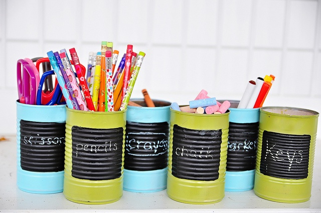 paint cans with paint and chalkboard paint to hold school supplies