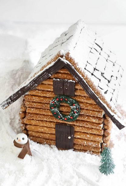 This cabin uses traditional gingerbread and a facade of pretzels for the log cabin look.