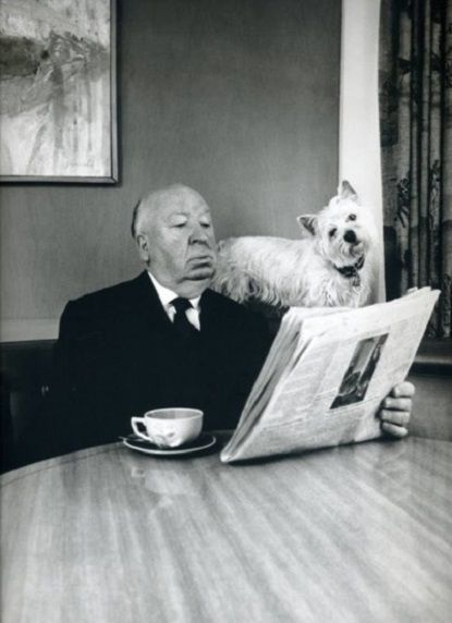 Alfred Hitchcock and his Westie reading the morning newspaper