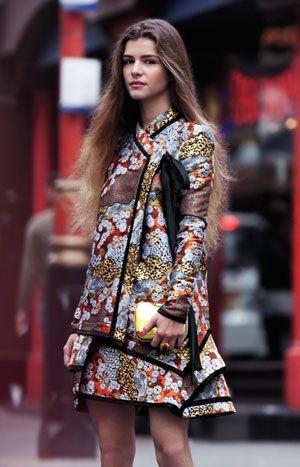 Yentob Wears Proenza Schouler Brocade Dress. Fendi Mirrored Clutch; Pebble London Gold-Plate And Carnelian Ring.