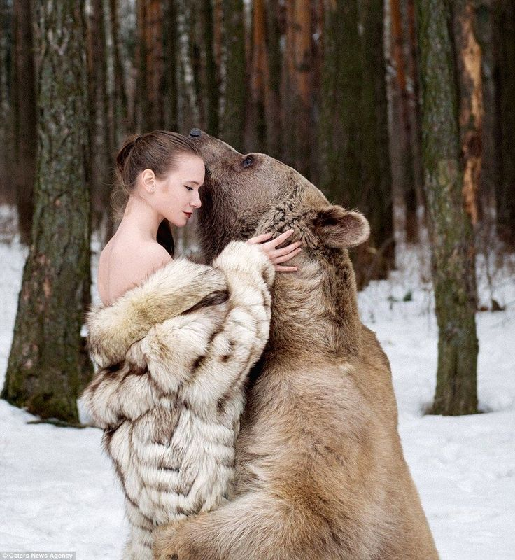 Models strips and poses seductively with a BEAR for bizarre anti-hunting campaign (so why did she decide to wear a fur coat?) I still wonder ?