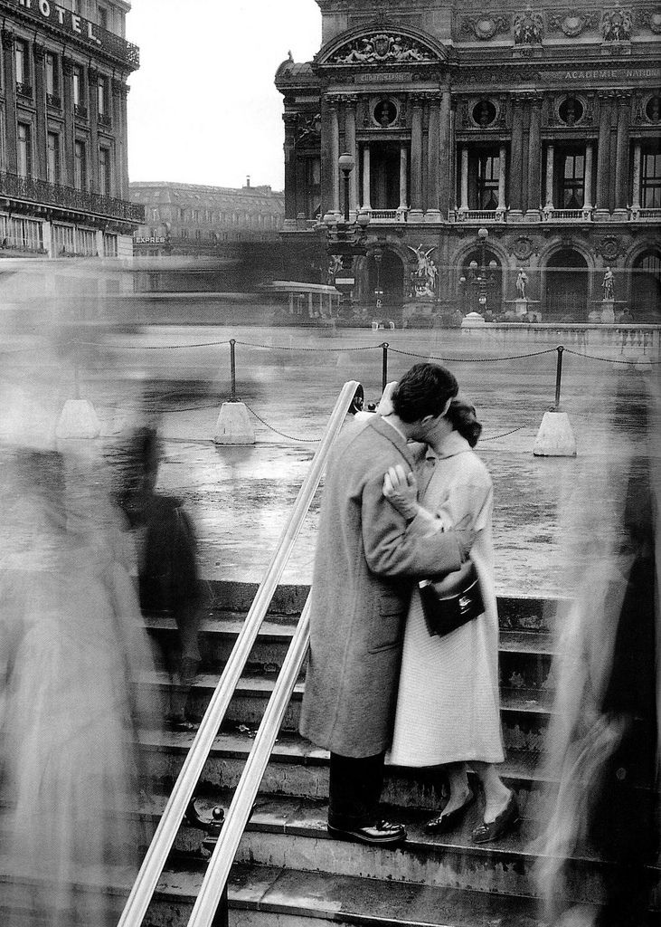 I love that the movement on either side makes it seem that the couple have been kissing for a long time,in their own time. by Doisneau