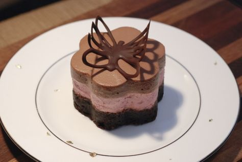 New Year's dessert with brownie base, raspberry mousse and chocolate mousse / Nytårsdessert med brownie bund, chokolademousse og hindbærmousse