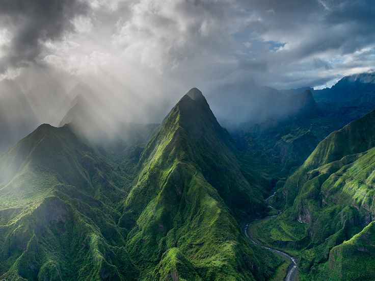 Picture of sun and clouds over mountains on the island of Reunion