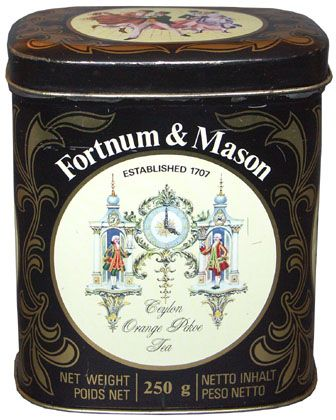 vintage Fortnum & Mason Ceylon Orange Pekoe Tea tea tins, art of famed storefront clock with store founders in Georgian dress flanking a clock face w/ hands at four o'clock and gold scroll pattern on black, square w/ rounded corners, n.d., London, UK