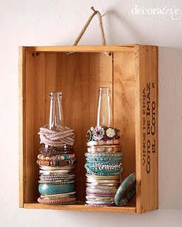 I like the shallow box idea for the jewelry holder, but I'd put hooks in it rather than bottles