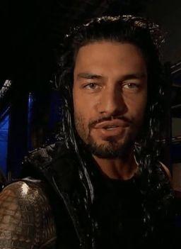 Roman Reigns smiling.