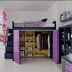 Loft bed with built-in wardrobe.. I wonder if we could somehow convert J's bunk beds into this??