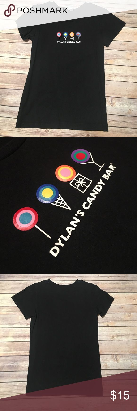 Dylan's Candy Bar Tee Dylan's Candy Bar Tee. Black Short Sleeve Tee with signature Dylan's Candy Bar Logo.  Shirt fit runs small. Dylan's Candy Bar Tops Tees - Short Sleeve
