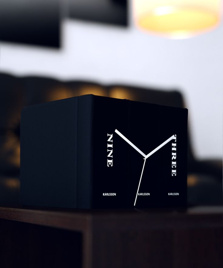 If you are not a fan of digital room clocks or a hanging clock this is a great choice. It has a great design, can blend in with everything an also it can tell you the time.  http://www.amazon.co.uk/Karlsson-Book-Clock-20-Black/dp/B000LRLEEI/ref=as_sl_pc_ss_til?tag=httpefevresbl04-21&linkCode=w01&linkId=&creativeASIN=B000LRLEEI