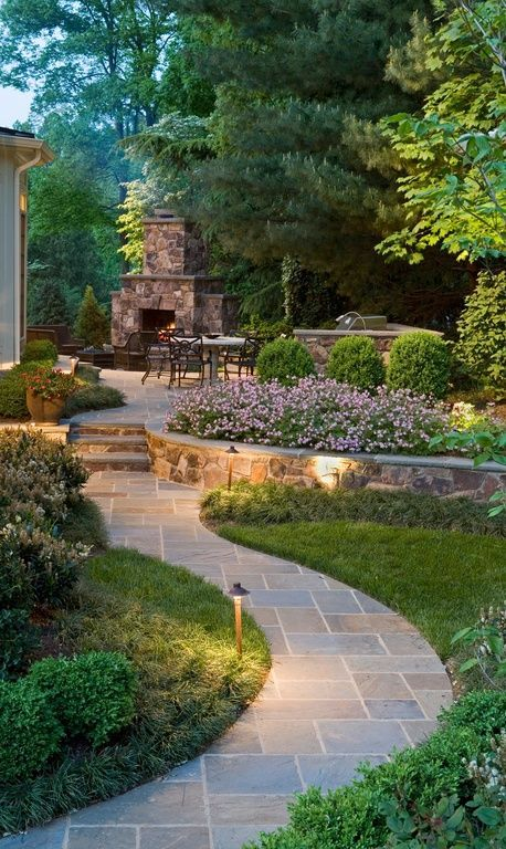 Transitional Landscape/Yard with Country Rubble Stone Veneer, outdoor pizza oven, Outdoor kitchen, Pathway, Raised beds