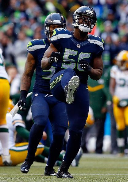 Green Bay Packers vs. Seattle Seahawks - Cliff Avril #56 of the Seattle Seahawks reacts making a sack during the third quarter of the 2015 NFC Championship game against the Green Bay Packers at CenturyLink Field on January 18, 2015 in Seattle, Washington. (Photo by Tom Pennington/Getty Images)