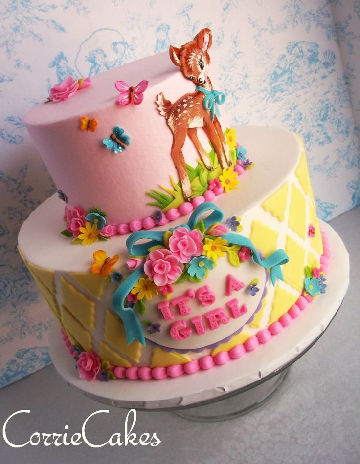 """Baby Shower - 6"""" and 10"""" iced in buttercream with MMF decorations. The fawn was made with thinly rolled fondant that was hand cut , layered and painted with gel colors. Design based off baby shower invitation."""