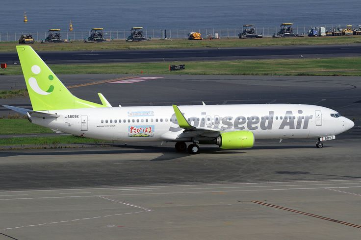 Solaseed (JP) Boeing 737-86N JA809X aircraft, with the sticker ''Sora-Koi Project'' featuring the 80th nanniversary of the administration of Takaharu Town, Miyazaki Prefecture on the airframe, skating at Japan Tokyo Haneda International Airport. 25/10/14.