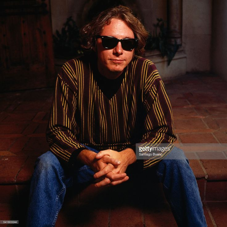 American bass guitarist Mike Mills from rock band R.E.M. (composed of guitarist Peter Buck, lead vocalist Michael Stipe, and drummer/percussionist Bill Berry).