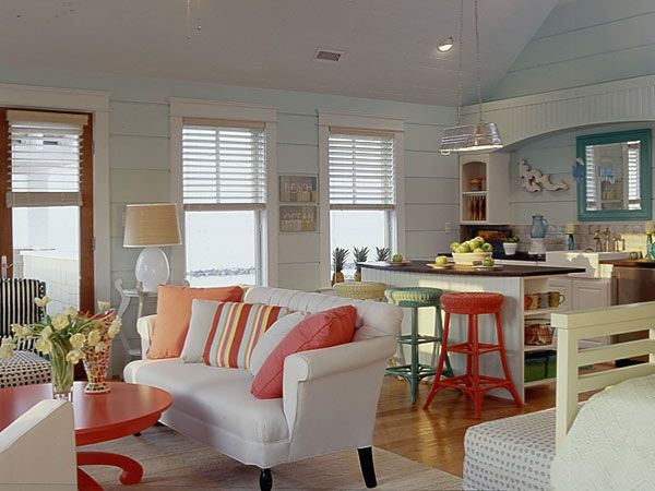 Painted wicker stools tie together the warm colors of the family room and kitchen