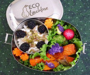 A colorful salad in the #reusable #oval #lunchbox by #ECOlunchbox