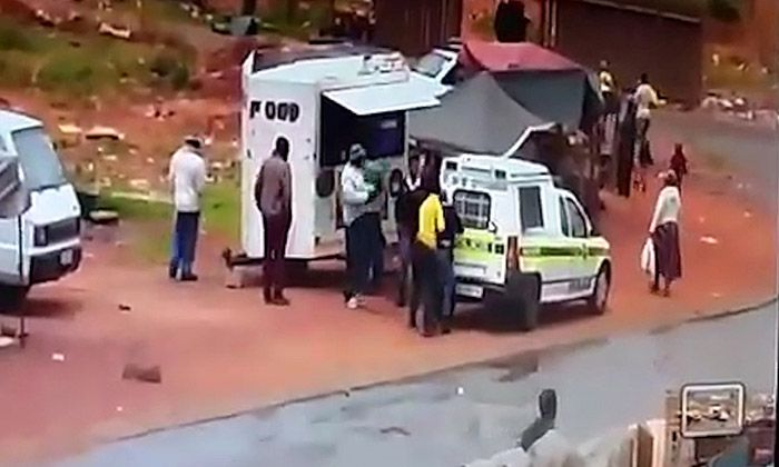 Cops robbed and pushed into police van