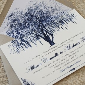 Oak Tree with Filigree Details Wedding Invitation (Vintage Blue) Classic and simple, this wedding invitation is ideal for a southern outdoor wedding. The invite centers around a dramatic weeping oak tree with elegant fonts and filigree details in a vintage cobalt blue.