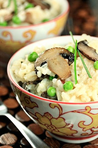 Mushroom risotto simplified by preparing it in a rice cooker. This deliciously creamy risotto recipe is full of mushrooms, peas and shallots and could not be easier.