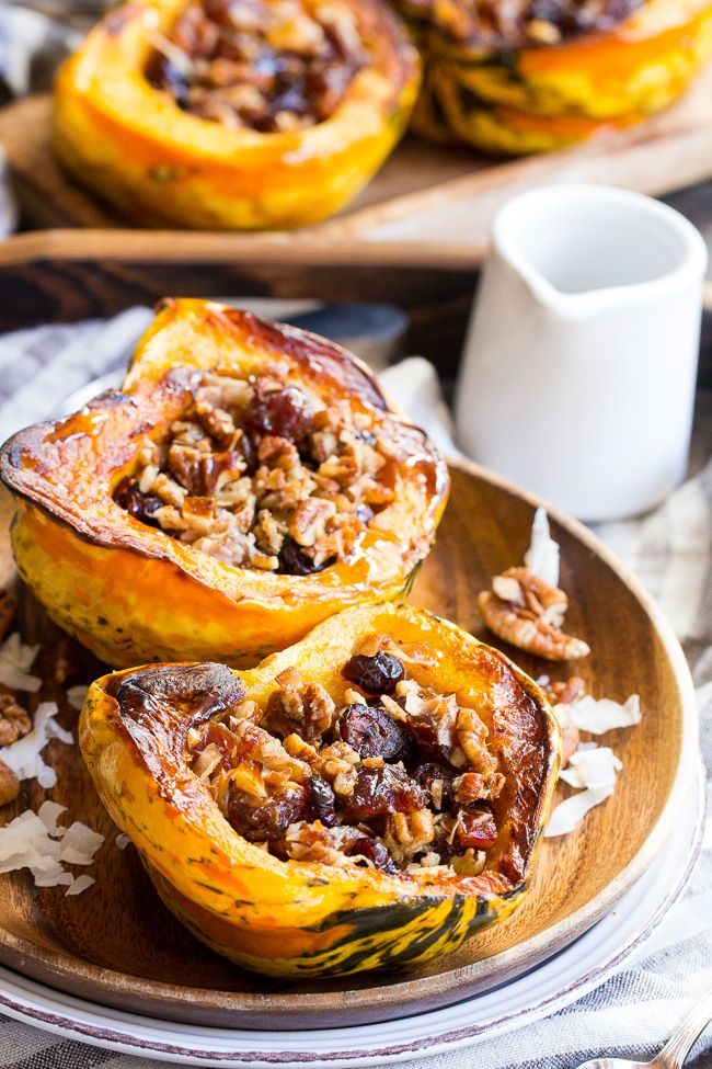 """Winter squash is roasted, filled with a sweet """"candy"""" mixture, drizzled with maple and roasted again to combine flavors. This paleo and vegan roasted squash recipe is perfect as a sweet side dish for the holidays, or a dessert!"""