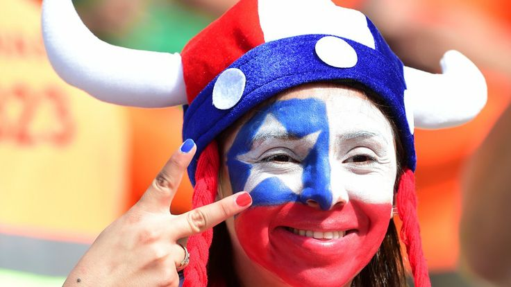 A Chilean fan reacts prior to a Group B football match between Netherlands and Chile