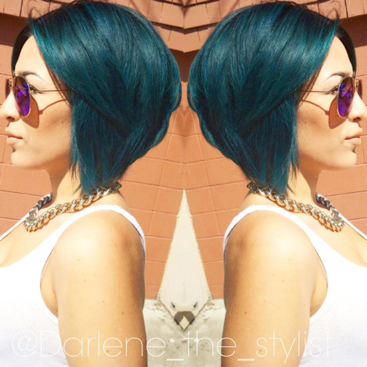 Short aline with dark roots colormelted into a teal color