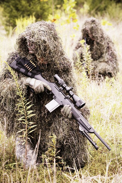 Hilarious picture where the sniper has gone to all the trouble of prepping a gillie suit, etc. Then he not only uses an unproven FNAR 308, but he puts a black buttstock pouch on a bright black, sticks out like a sore thumb, rifle.